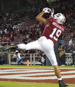 Stanford wide receiver JJ Arcega-Whiteside scores a touchdown in the second half against Washington State during an NCAA college football game on Saturday, Oct. 27, 2018, in Stanford, Calif. (AP Photo/Don Feria)