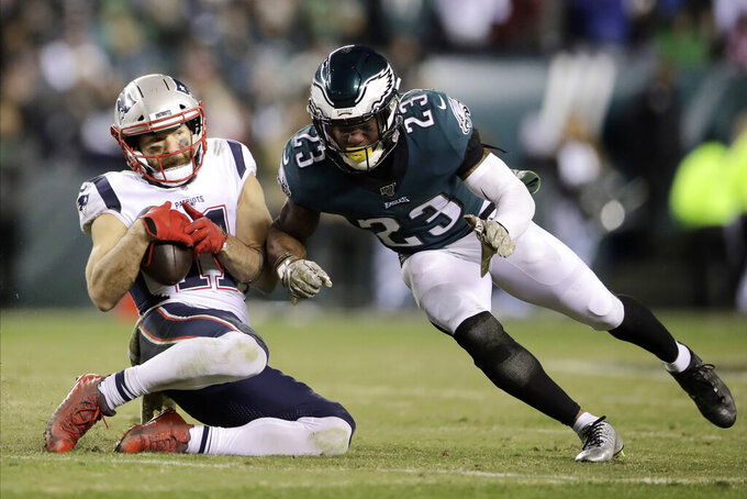 New England Patriots' Julian Edelman (11) catches a pass against Philadelphia Eagles' Rodney McLeod (23) during the second half of an NFL football game, Sunday, Nov. 17, 2019, in Philadelphia. (AP Photo/Matt Rourke)