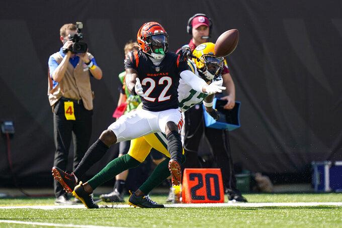 Cincinnati Bengals cornerback Chidobe Awuzie (22) intercept a pass intended for Green Bay Packers wide receiver Davante Adams (17) in the first half of an NFL football game in Cincinnati, Sunday, Oct. 10, 2021. (AP Photo/Bryan Woolston)