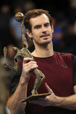 Andy Murray of Britain poses with the trophy after winning the European Open final tennis match in Antwerp, Belgium, Sunday, Oct. 20, 2019. Murray defeated Stan Wawrinka of Switzerland 3-6/6-4/6-4. (AP Photo/Francisco Seco)