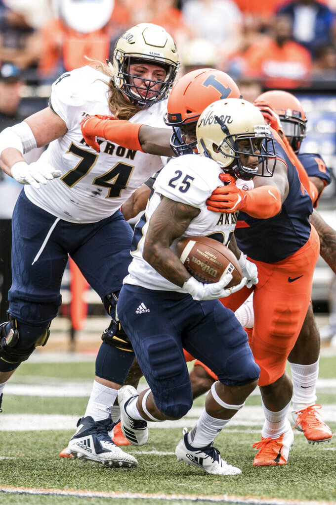 Akron's Brandon Lee (4) runs the ball in the first half of an NCAA college football game against Illinois, Saturday, Aug. 31, 2019, in Champaign, Ill. (AP Photo/Holly Hart)