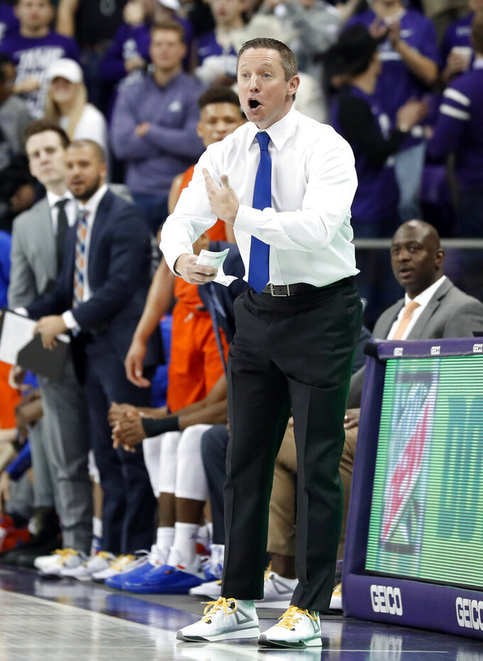 Florida head coach Mike White and members of his staff look on during the second half of an NCAA college basketball game against TCU in Fort Worth, Texas, Saturday, Jan. 26, 2019. (AP Photo/Tony Gutierrez)