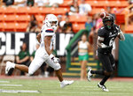 Hawaii wide receiver Cedric Byrd II (6) pulls in a pass next to Arizona safety Christian Young (5) during the first quarter of an NCAA college football game Saturday, Aug. 24, 2019, in Honolulu. (AP Photo/Marco Garcia)