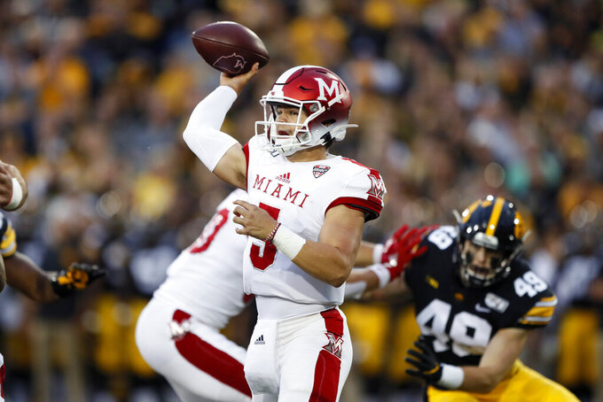 Miami of Ohio quarterback Brett Gabbert throws a pass during the first half of an NCAA college football game against Iowa, Saturday, Aug. 31, 2019, in Iowa City, Iowa. (AP Photo/Charlie Neibergall)