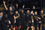 Northwestern's bench celebrates a 3-point basket against DePaul during the first half of an NCAA college basketball game, Saturday, Dec. 21, 2019, in Chicago. (AP Photo/David Banks)