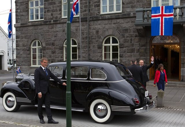 Iceland's president Guðni Th. Jóhannesson waves as he gets into a car following his inauguration in Reykjavik, Iceland Saturday Aug. 1, 2020. In Iceland, a nation so safe that its president runs errands on a bicycle, U.S. Ambassador Jeffery Ross Gunter has left locals aghast with his request to hire armed bodyguards.  He's also enraged lawmakers by casually and groundlessly hitching Iceland to President Donald Trump's controversial
