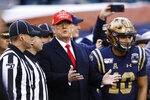 President Donald Trump speaks with officials ahead of an NCAA college football game between Army and Navy, Saturday, Dec. 14, 2019, in Philadelphia. (AP Photo/Matt Slocum)