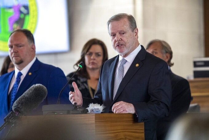 Senate leader Phil Berger answers questions from reporters during a press conference outlining the state budget Monday, June 21, 2021 at the North Carolina Legislative Building. The budget includes tax cuts, raises and bonuses. (Travis Long/The News & Observer via AP)
