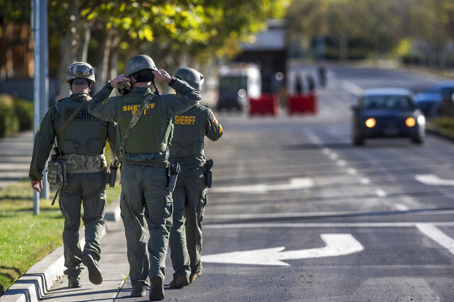FILE - In this Nov. 4, 2015, file photo, Merced County Sheriff SWAT members enter the University of California, Merced campus after a reported stabbing in Merced, Calif. Authorities determined that Faisal Mohammad, an 18-year-old freshman at the university had no connections to organized hate or terror groups and no past behavior to suggest violence. (Andrew Kuhn/The Merced Sun-Star via AP, File)