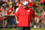 FILE - In this Aug. 2, 2019, file photo, Kansas City Chiefs head coach Andy Reid watches drills during NFL football training camp, in St. Joseph, Mo. There's a good chance Juan Thornhill will start at safety for the Chiefs in Week 1. That bucks a trend not only for coach Andy Reid but also defensive coordinator Steve Spagnuolo when it comes to rookies.(AP Photo/Charlie Riedel, File)