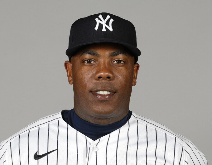 FILE - In this Feb. 20, 2020, file photo, New York Yankee closer Aroldis Chapman poses for a photo in Tampa Fla. Yankees manager Aaron Boone announced Saturday, July 11, 2020, that Chapman has tested positive for the coronavirus and is experiencing mild symptoms. (AP Photo/Frank Franklin II, File)