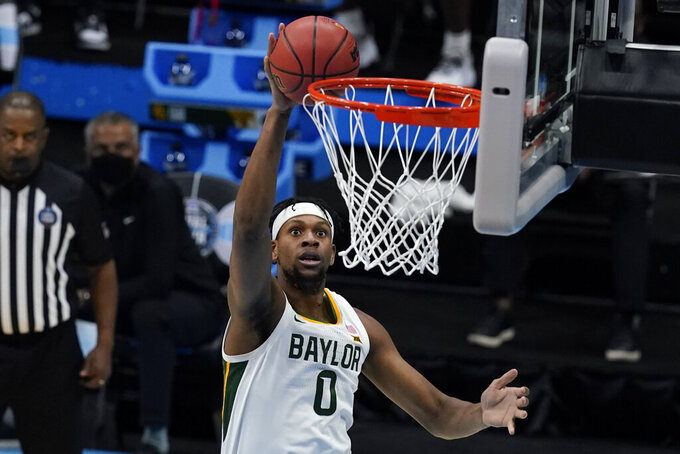 Baylor forward Flo Thamba (0) shoots during the second half of a men's Final Four NCAA college basketball tournament semifinal game against Houston, Saturday, April 3, 2021, at Lucas Oil Stadium in Indianapolis. (AP Photo/Darron Cummings)