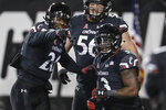 Cincinnati running back Michael Warren II, right, celebrates scoring a touchdown with wide receiver Jerron Rollins, left, during the second half of an NCAA college football game against South Florida, Saturday, Nov. 10, 2018, in Cincinnati. (AP Photo/John Minchillo)