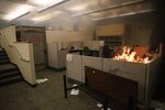 In this March 29, 2020, photo, a fire burns in an office during protests in response to the Minneapolis death of George Floyd in Portland, Oregon. (Dave Killen/The Oregonian via AP)