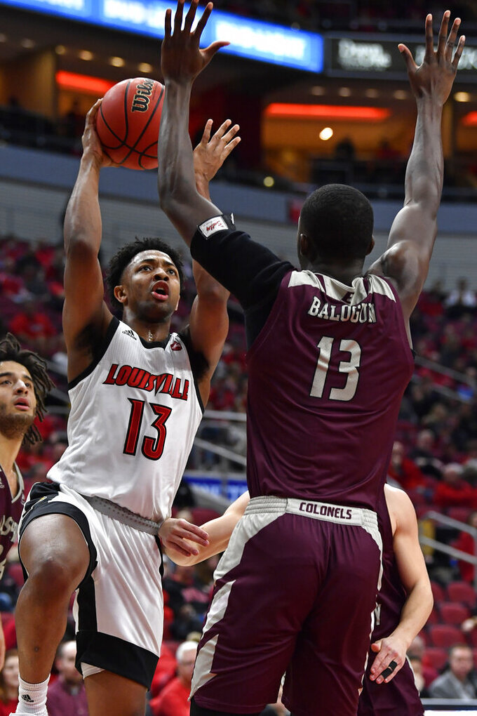 Louisville guard David Johnson (13) attempts a shot over the defense of Eastern Kentucky forward Tariq Balogun (13) during the second half of an NCAA college basketball game in Louisville, Ky., Saturday, Dec. 14, 2019. Louisville won 99-67. (AP Photo/Timothy D. Easley)