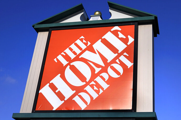A Home Depot store sign is visible from Route 102, Wednesday, Nov. 18, 2020, in Londonderry, N.H.  Home Depot has reached a $17.5 million settlement with the attorney generals of most U.S. states over a 2014 data breach in which the payment card information of some 40 million customers was exposed. The Massachusetts Attorney General's office detailed the settlement in a statement Tuesday, Nov. 24.  (AP Photo/Charles Krupa)
