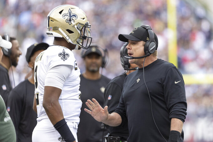 FILE - New Orleans Saints quarterback Jameis Winston (2) talks with head coach Sean Payton during the first half of an NFL football game in Foxborough, Mass., in this Sunday, Sept. 26, 2021, file photo. Ron Rivera has faced an opponent coached by Sean Payton and one quarterbacked by Jameis Winston plenty of times before. Now he has to deal with the combination when Washington hosts Payton, Winston and the New Orleans Saints in a matchup of teams with no shortage of concerns. (AP Photo/Greg M. Cooper, File)