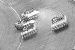 FILE - In this May 14, 1962, file photo, Ralph Earnhardt (75), far left,  starts to spin out as he attempts to pass Emanuel Zervakis (20) on the first turn during the Rebel 300 auto race at the Darlington Raceway in Darlington, S.C.. The other drivers are Johnny Allen (47) and Ned Jarrett (11). The 70-year-old raceway will host the return of NASCAR Cup Series racing, among the biggest events so far as sports makes a halting comeback from a global shutdown forced by the coronavirus pandemic.(AP Photo/Spencer Jones, File)