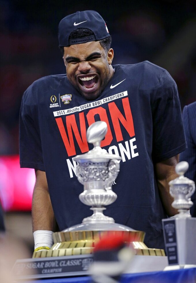 FILE - In this Jan. 1, 2015, file photo, Ohio State running back Ezekiel Elliott celebrates after the Sugar Bowl NCAA college football playoff semifinal game against Alabama, in New Orleans. Ohio State won 42-35. (AP Photo/Bill Haber, File)