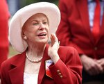 FILE - In this Aug. 28, 2015 file photo Marylou Whitney of Marylou Whitney Stables talks to reporters after being inducted to the New York Racing Association 2015 Saratoga Walk of Fame during the annual Red Jacket Ceremony at Saratoga Race Course in Saratoga Springs, N.Y. Philanthropist, socialite and horse-racing enthusiast Marylou Whitney, known as the