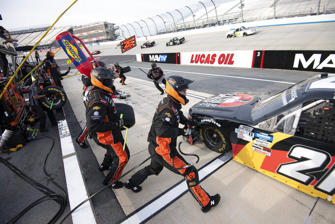 Zane Smith (21) pits during a NASCAR Truck Series race at Dover International Speedway, Friday, Aug. 21, 2020, in Dover, Del. (AP Photo/Jason Minto)