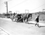 FILE - In this Oct. 11, 1945, file photo, an elderly bearded Japanese leads a horse pulling a wagon loaded with other members of the family and their household goods past the wreckage of buildings on the outskirts of Tokyo as people return to their home after having evacuated during U.S. air raids on the Japanese capital. The bombs stopped falling 75 years ago, but it is entirely possible - crucial even, some argue - to view the region's world-beating economies, its massive cultural and political reach and its bitter trade, territory and history disputes all through a single prism: Japan's aggression in the Pacific during World War II. (AP Photo/Max Desfor, File)