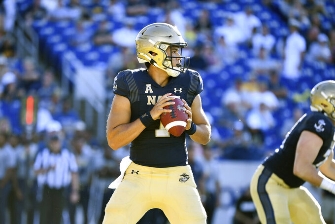 Navy quarterback Tai Lavatai drops back to pass during the second half of an NCAA college football game against Marshall, Saturday, Sept. 4, 2021, Annapolis, Md. (AP Photo/Terrance Williams)