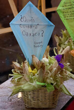 """A kite with a message sent via twitter by Spanish Singer Enrique Bunbury that reads """"Who will take care of Oaxaca?"""" is displayed at a memorial for the late Mexican painter Francisco Toledo, during a memorial at the Bellas Artes Palace in Mexico City, Friday, Sept. 6, 2019. Toledo, who was well-known and respected in Mexico both for his art and his activism, has died, the country's president announced late Thursday. (AP Photo/Eduardo Verdugo)"""
