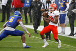 Sam Houston State wide receiver Chandler Harvin (88) makes a catch in front of South Dakota State safety Michael Griffin II (6) during the first half of the NCAA college FCS Football Championship in Frisco, Texas, Sunday, May 16, 2021. (AP Photo/Michael Ainsworth)