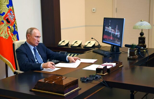 Russian President Vladimir Putin attends a meeting via video conference at the Novo-Ogaryovo residence outside Moscow, Russia, Tuesday, Dec. 8, 2020. (Alexei Nikolsky, Sputnik, Kremlin Pool Photo via AP)