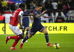 PSG's Lionel Messi, right, challenges for the ball with Reims' Marshall Munetsi during the France League One soccer match between Reims and Paris Saint-Germain, at the Stade Auguste-Delaune in Reims, France, Sunday, Aug. 29, 2021. (AP Photo/Francois Mori)