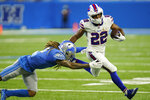 Detroit Lions defensive back Mike Ford attempts a tackle on Buffalo Bills running back Matt Breida (22) during the first half of a preseason NFL football game, Friday, Aug. 13, 2021, in Detroit. (AP Photo/Paul Sancya)