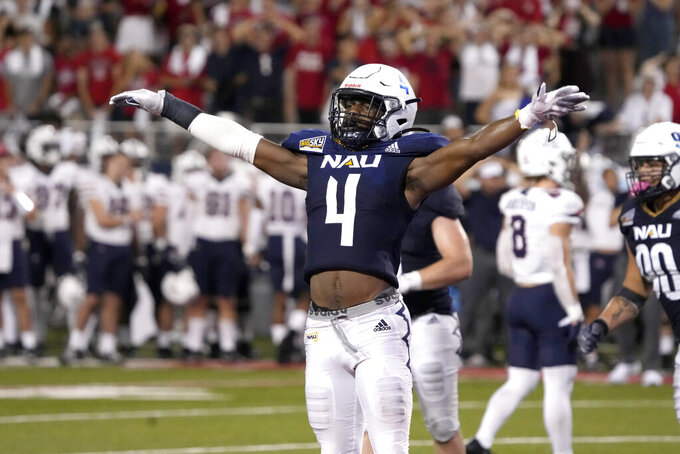 Northern Arizona defensive back Brenndan Johnson (4) reacts after stopping Arizona on a two point conversion during the second half of an NCAA college football game, Saturday, Sept. 18, 2021, in Tucson, Ariz. Northern Arizona won 21-19. (AP Photo/Rick Scuteri)