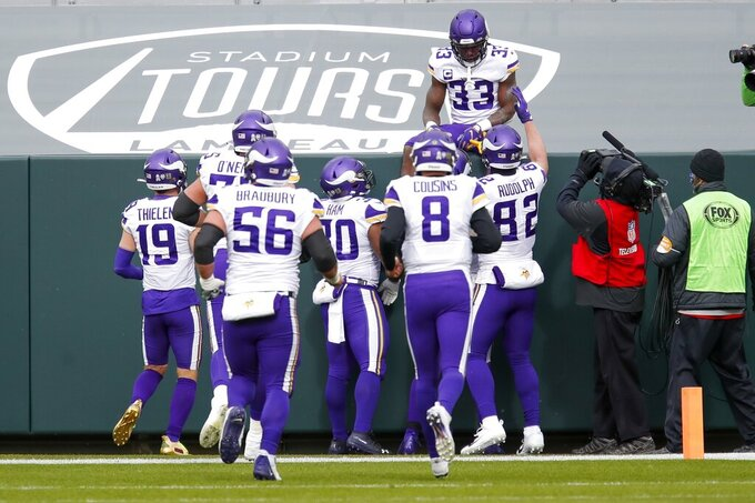 Minnesota Vikings' Dalvin Cook celebrates his touchdown run during the first half of an NFL football game against the Green Bay Packers Sunday, Nov. 1, 2020, in Green Bay, Wis. (AP Photo/Matt Ludtke)