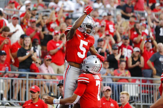 Ohio State receiver Garrett Wilson (5) celebrates his touchdown against Tulsa during the second half of an NCAA college football game Saturday, Sept. 18, 2021, in Columbus, Ohio. (AP Photo/Jay LaPrete)