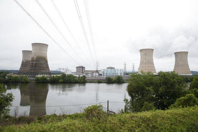 FILE - In this May 22, 2017 file photo shown is the Three Mile Island nuclear power plant in Middletown, Pa. With nuclear power plant owners seeking a rescue in Pennsylvania, a number of state lawmakers are signaling that they are willing to help, with conditions.  Giving nuclear power plants what opponents call a bailout could mean a politically risky vote to hike electric bills. (AP Photo/Matt Rourke, File)