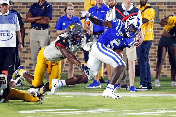 Jalon Calhoun (5) breaks away from North Carolina A&T's Joseph Stuckey (8) to score a touchdown during the second half of an NCAA college football game in Durham, N.C., Saturday, Sept. 7, 2019. (AP Photo/Karl B DeBlaker)