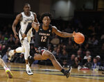 South Carolina guard Trae Hannibal (12) drives past Vanderbilt's Maxwell Evans in the second half of an NCAA college basketball game Saturday, March 7, 2020, in Nashville, Tenn. Vanderbilt won 83-74. (AP Photo/Mark Humphrey)