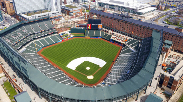 FILE - In this Thursday, March 26, 2020, file photo, Oriole Park at Camden Yards is closed on what would've been Opening Day in Baltimore, Md. Whenever baseball returns because of the coronavirus pandemic, there's an element that might come into play like never before: the sound of silence.  (AP Photo/Steve Helber, File)