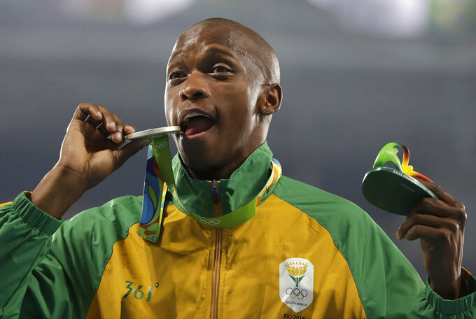 FILE - In this Sunday, Aug. 14, 2016 file photo, South Africa's Luvo Manyonga poses with his silver medal during the long jump medals at the 2016 Summer Olympics at the Olympic stadium in Rio de Janeiro, Brazil. Olympic long jump silver medalist Luvo Manyonga has been banned for four years over missed doping tests. He will miss the next two Olympic Games. Track and field's Athletics Integrity Unit said on Friday, June 18, 2021 Manyonga had three violations of so-called whereabouts rules in a one-year period.  (AP Photo/Kirsty Wigglesworth, file)