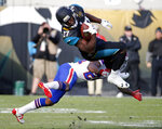 FILE - In this Jan. 7, 2018, file photo, Jacksonville Jaguars running back Leonard Fournette (27) makes a reception over Buffalo Bills defensive back Leonard Johnson in the second half of an NFL wild-card playoff football game in Jacksonville, Fla. Fournette missed seven full games and half of two others with hamstring and foot injuries. He was suspended for another after coming off the bench and punching Buffalo defensive lineman Shaq Lawson. What Fournette does will go a long way toward determining whether the Jaguars remain at the bottom of the AFC South or return to being conference contenders. (AP Photo/Stephen B. Morton)
