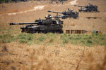 Israeli mobile artillery units sit in place in northern Israel near the border with Lebanon, Tuesday, July 28, 2020. Israeli security officials said soldiers exchanged fire with a