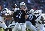 Oakland Raiders' Mike Glennon looks to pass against the Los Angeles Rams during the first half of a preseason NFL football game Saturday, Aug. 10, 2019, in Oakland, Calif. (AP Photo/Rich Pedroncelli)