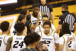 Missouri teammates surround Jeremiah Tilmon, center, after he scored in winning point in the final second of their victory over Bradley during the second half of an NCAA college basketball game Tuesday, Dec. 22, 2020, in Columbia, Mo. (AP Photo/L.G. Patterson)
