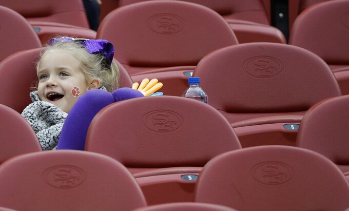 A young fan waits for the start of the NCAA college football playoff championship game between Alabama and Clemson Monday, Jan. 7, 2019, in Santa Clara, Calif. (AP Photo/David J. Phillip)