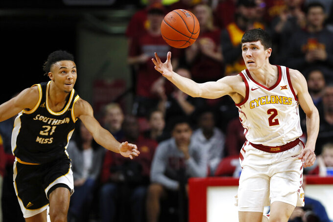 Iowa State guard Caleb Grill (2) runs down a loose ball ahead of Southern Mississippi guard Auston Leslie, left, during the first half of an NCAA college basketball game, Tuesday, Nov. 19, 2019, in Ames, Iowa. (AP Photo/Charlie Neibergall)
