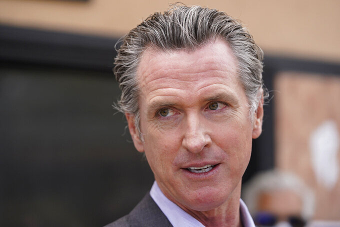 FILE - In this June 3, 2021 file photo California Gov. Gavin Newsom listens to questions during a news conference in San Francisco. Most of California's coronavirus rules governing public gatherings will disappear on Tuesday, June 15, 2021, after Newsom signed an executive order Friday afternoon that heralds the end of the pandemic's hold on much of public life for the nation's most populous state. (AP Photo/Eric Risberg, File)