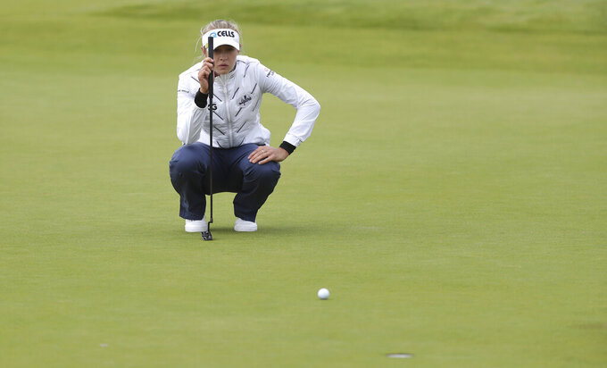 United States' NellyKorda looks at her putt on the 18th green during the first round of the Women's British Open golf championship, in Carnoustie, Scotland, Thursday, Aug. 19, 2021. (AP Photo/Scott Heppell)