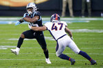 Carolina Panthers running back Rodney Smith is tackled by Denver Broncos linebacker Josey Jewell during the second half of an NFL football game Sunday, Dec. 13, 2020, in Charlotte, N.C. (AP Photo/Brian Blanco)