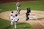 New York Mets manager Mickey Callaway (36) is ejected after arguing with home plate umpire Tripp Gibson, right, after Mets' Amed Rosario (1) was hit by a pitch from Philadelphia Phillies starting pitcher Jake Arrieta during the fifth inning a of a baseball game Saturday, July 6, 2019, in New York. (AP Photo/Frank Franklin II)